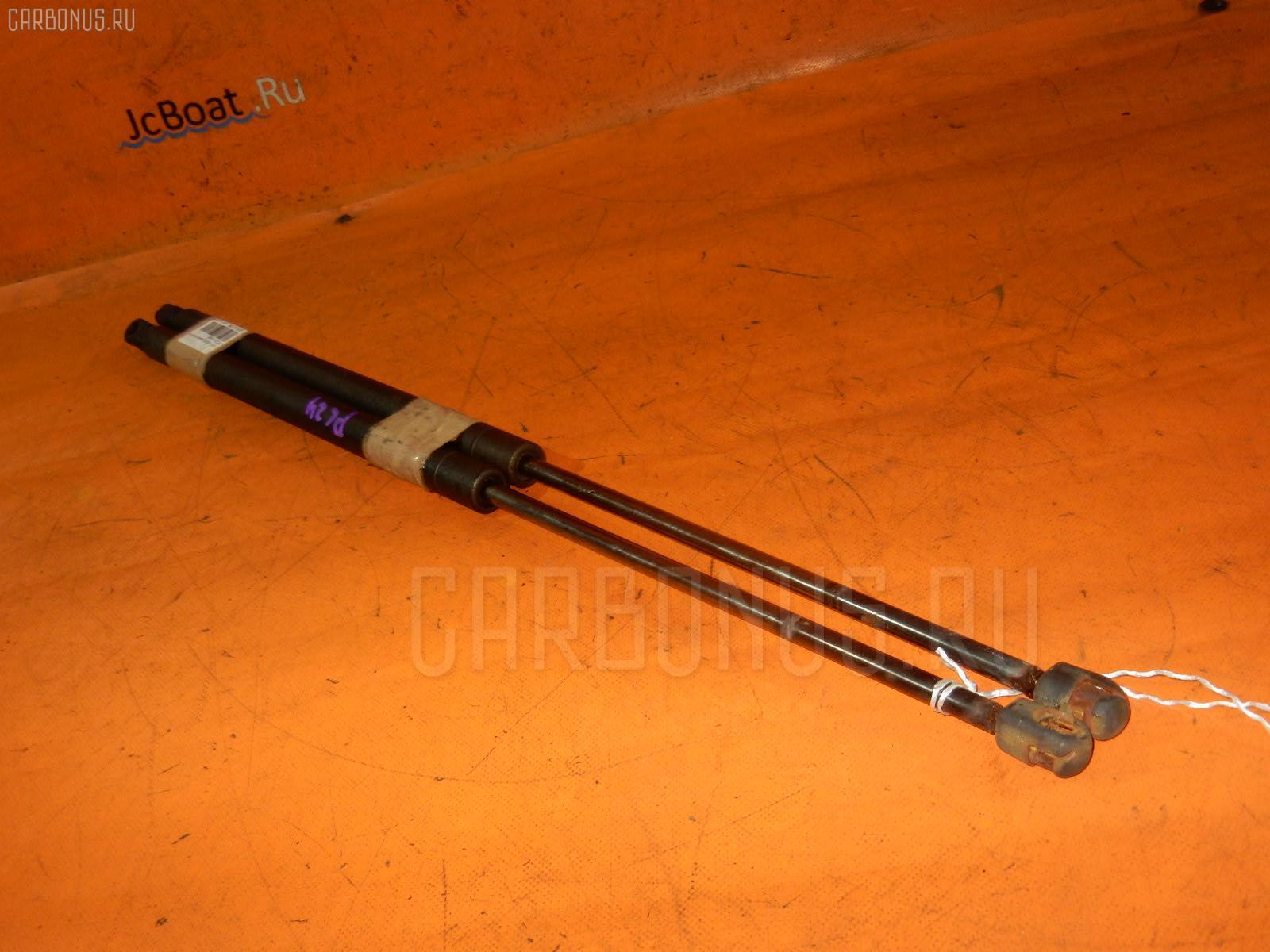 Амортизатор двери NISSAN SERENA PC24. Фото 5