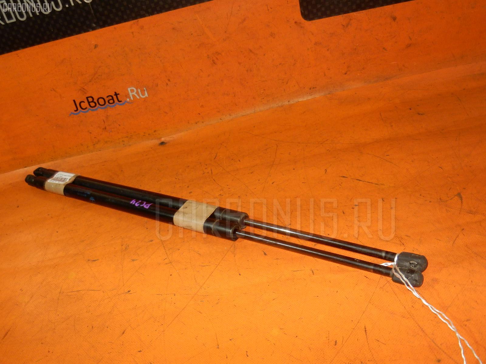 Амортизатор двери NISSAN SERENA PC24. Фото 8
