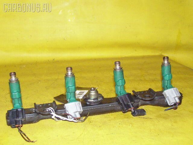 Форсунка инжекторная TOYOTA FUNCARGO NCP20 2NZ-FE. Фото 2