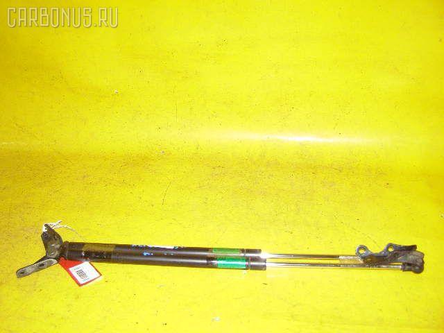 Амортизатор двери TOYOTA IST NCP60 Фото 1