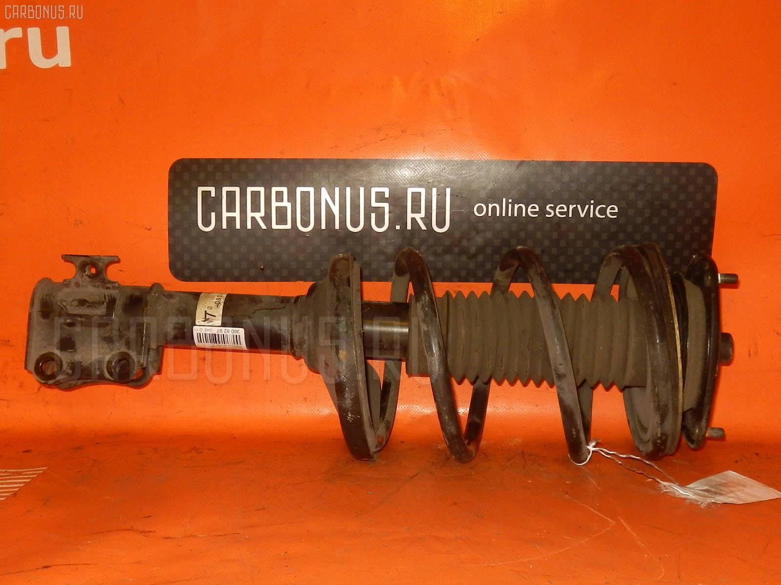 Стойка амортизатора Suzuki Aerio wagon RB21S M15A Фото 1
