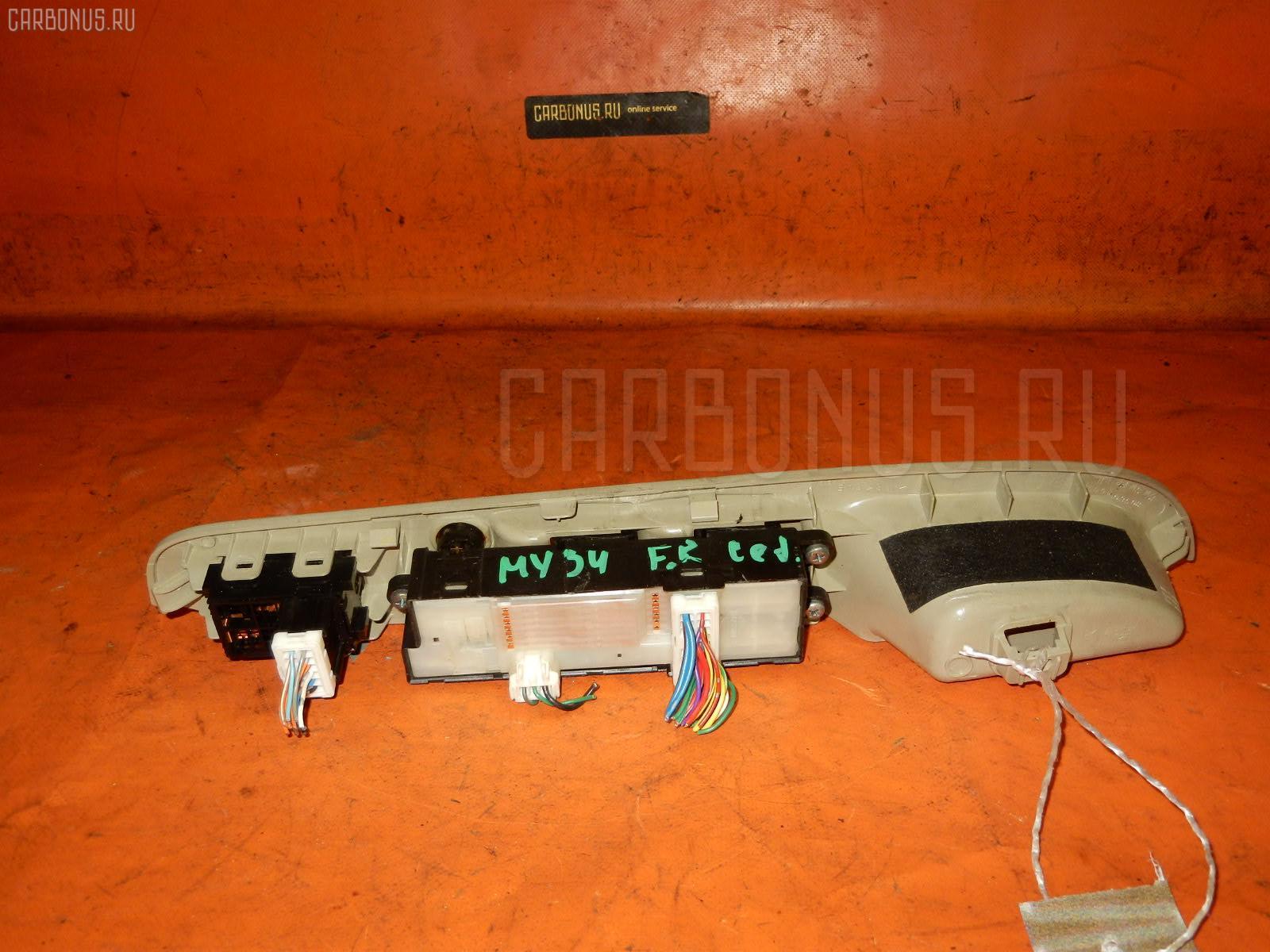 Блок упр-я стеклоподъемниками NISSAN CEDRIC MY34. Фото 1