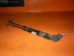 Амортизатор двери Toyota Caldina AZT241W Фото 1