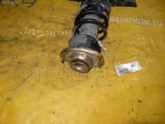 Стойка амортизатора NISSAN MOCO MG21S K6A 543034A0A0 Переднее Левое