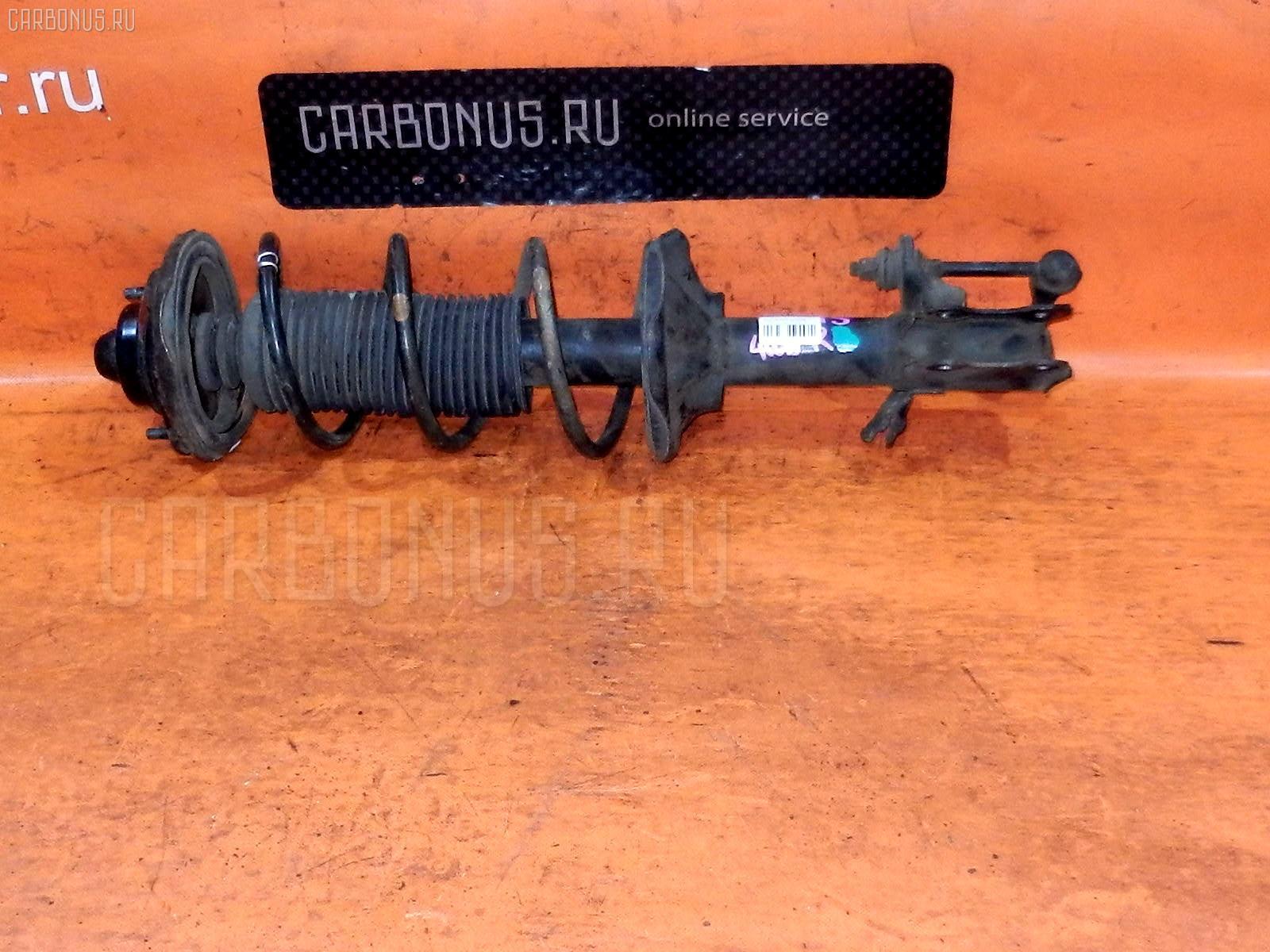 Стойка амортизатора NISSAN SUNNY FNB15 QG15DE. Фото 8