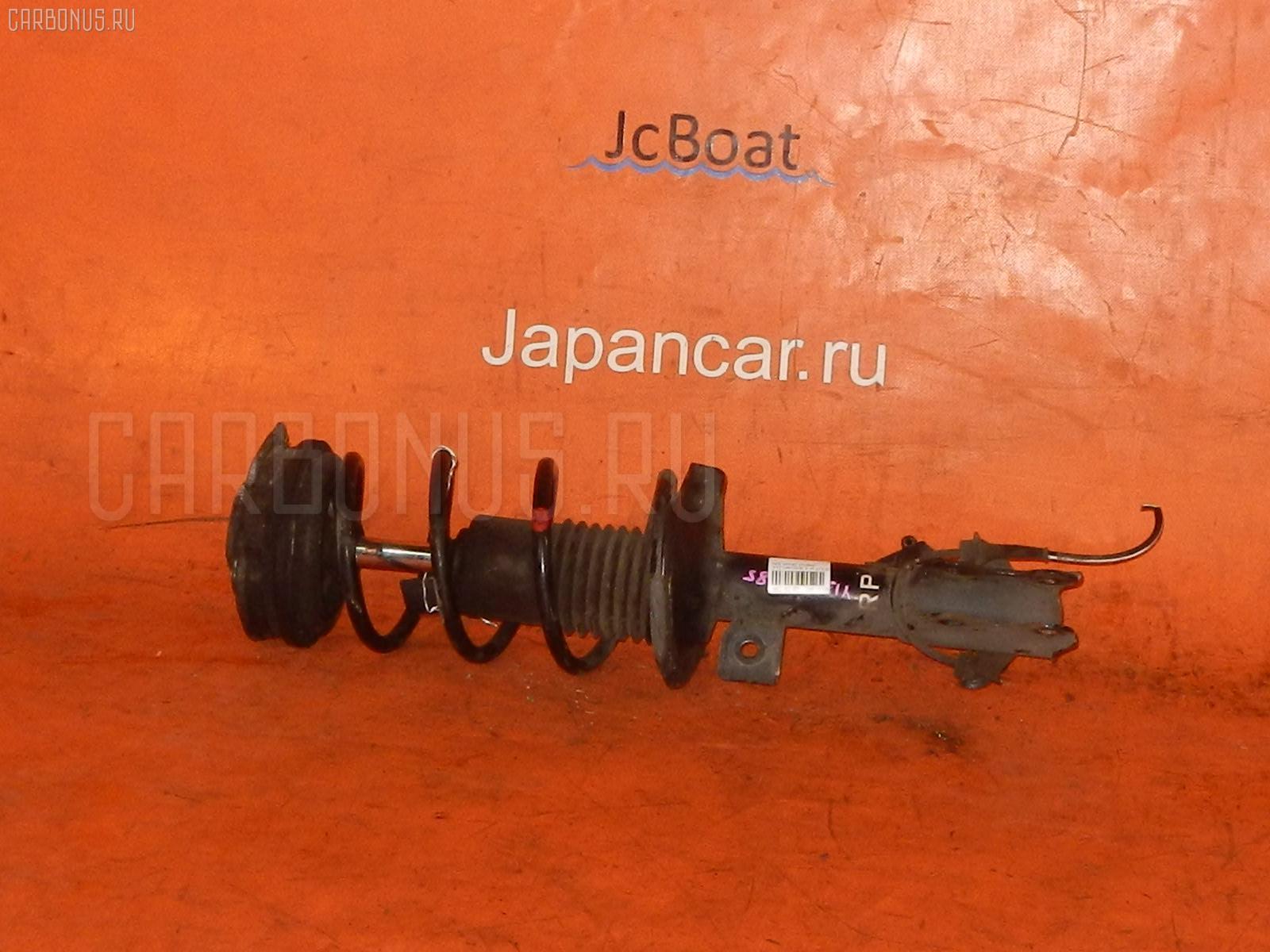 Стойка амортизатора Nissan Wingroad Y12 HR15DE Фото 1
