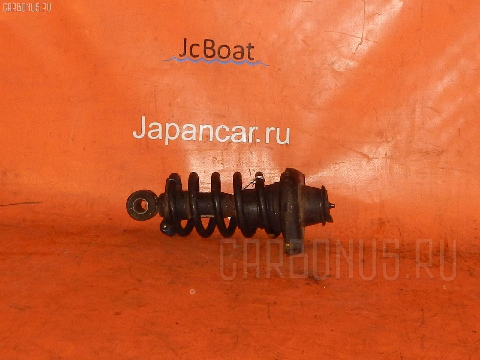 Стойка амортизатора NISSAN AVENIR RW11 QR20DE. Фото 1