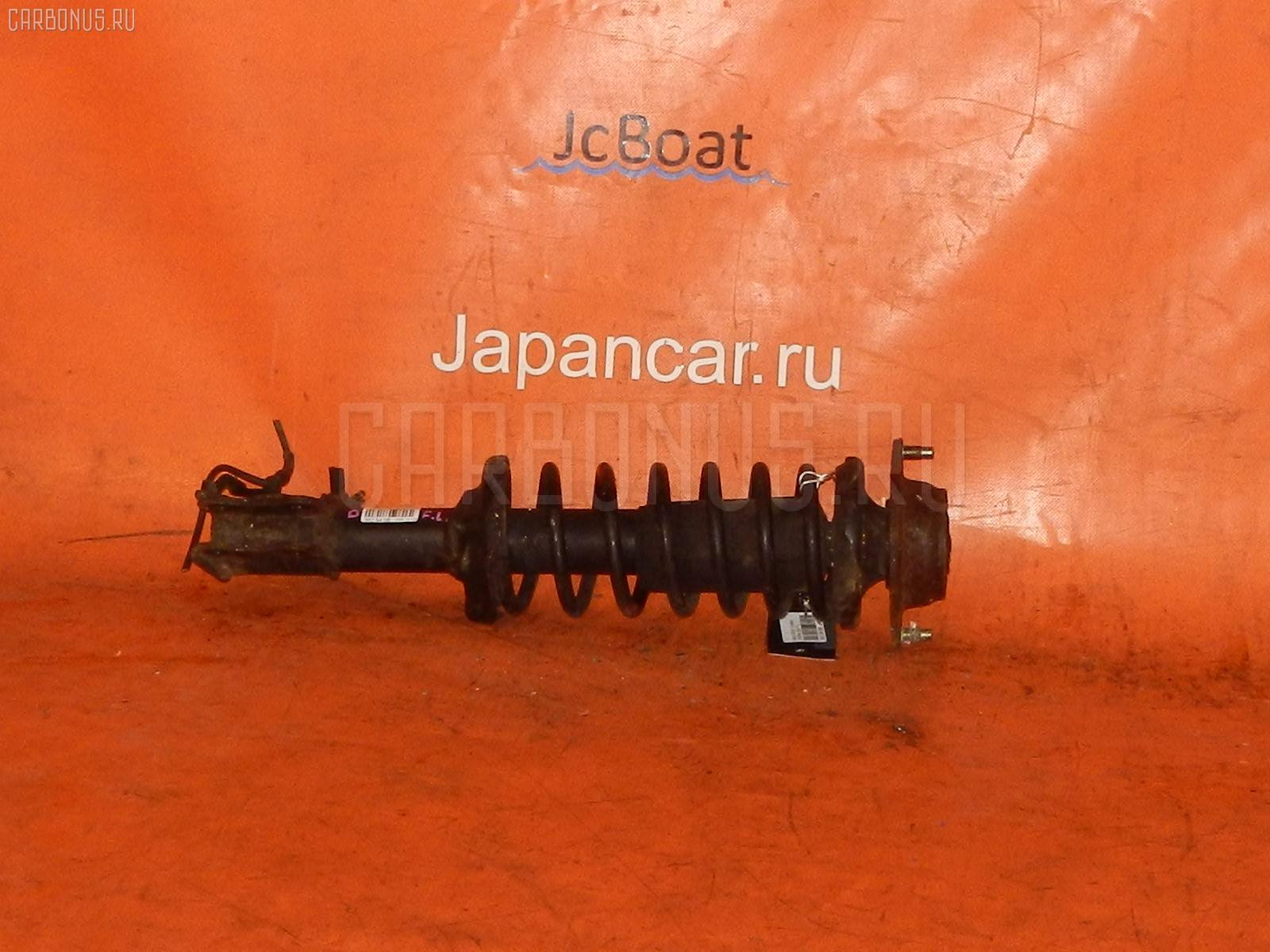 Стойка амортизатора Mazda Demio DW3W B3 Фото 1