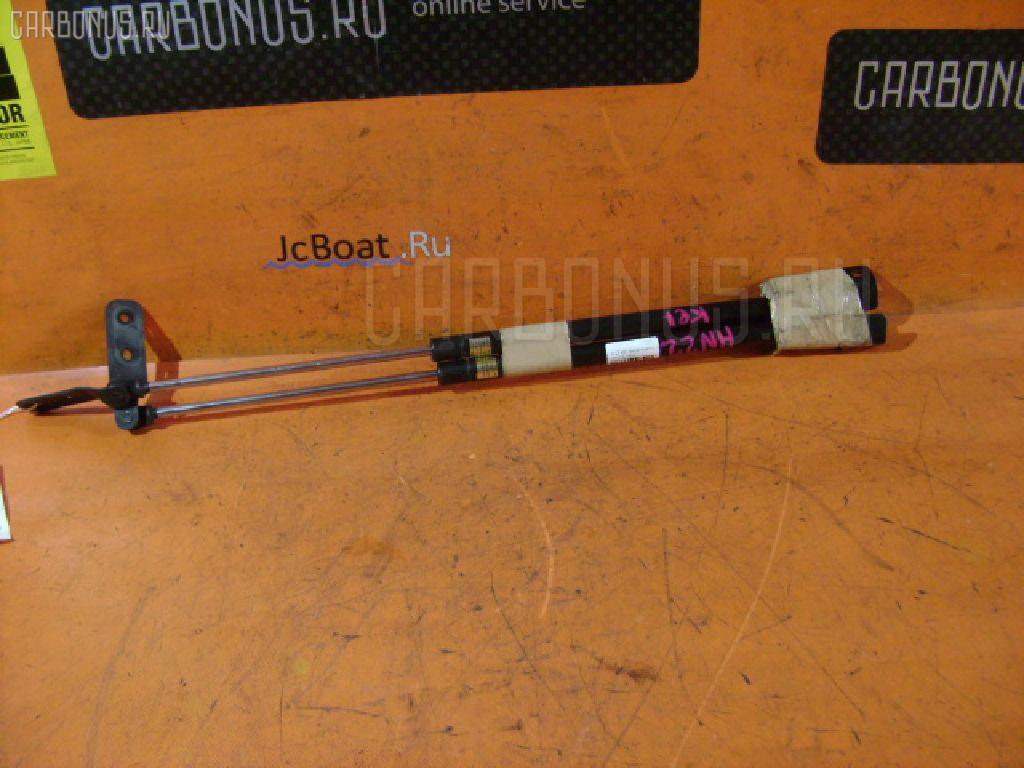 Амортизатор двери SUZUKI KEI HN22S. Фото 1