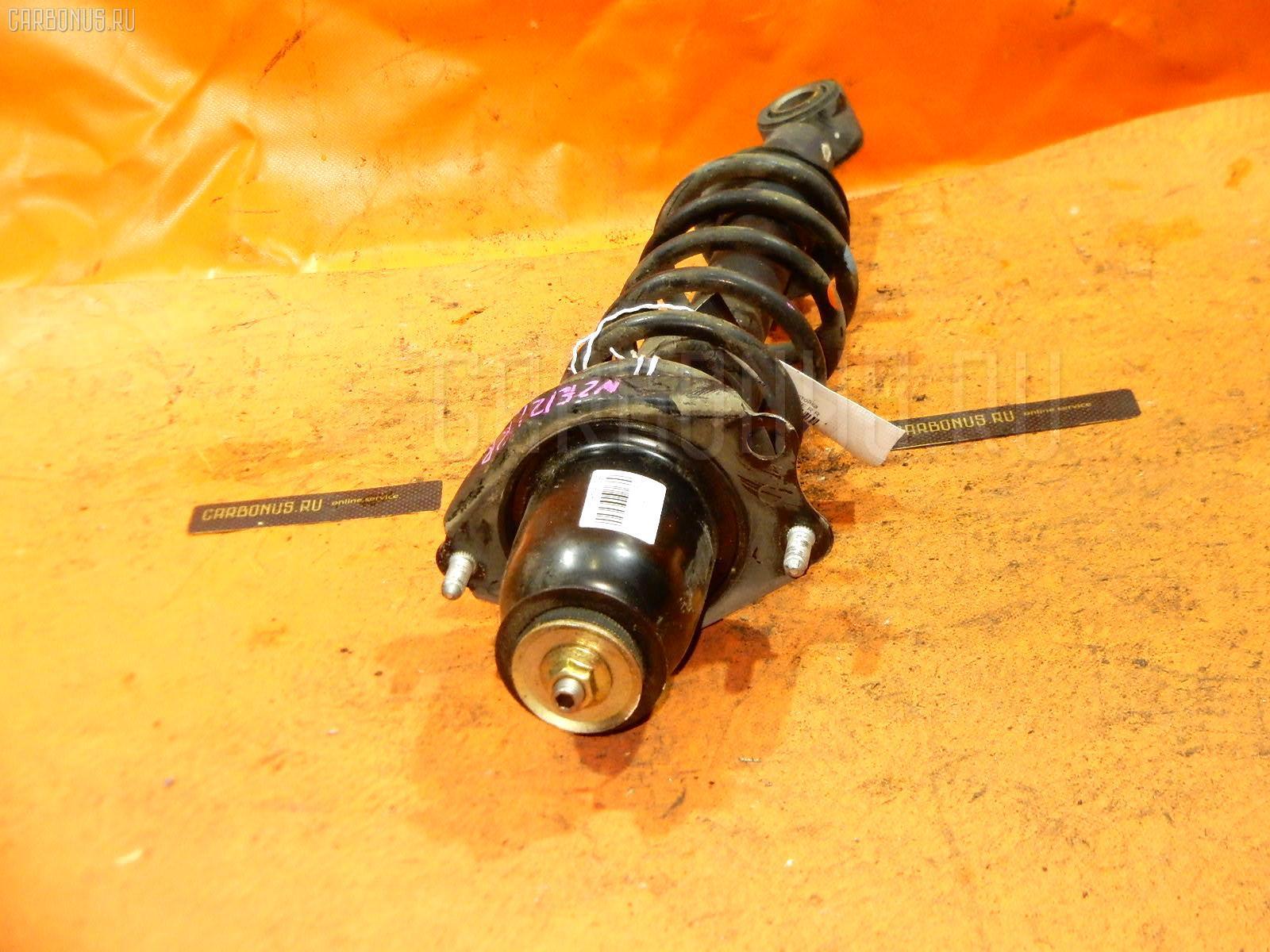 Стойка амортизатора TOYOTA COROLLA NZE121 1NZ-FE Фото 1