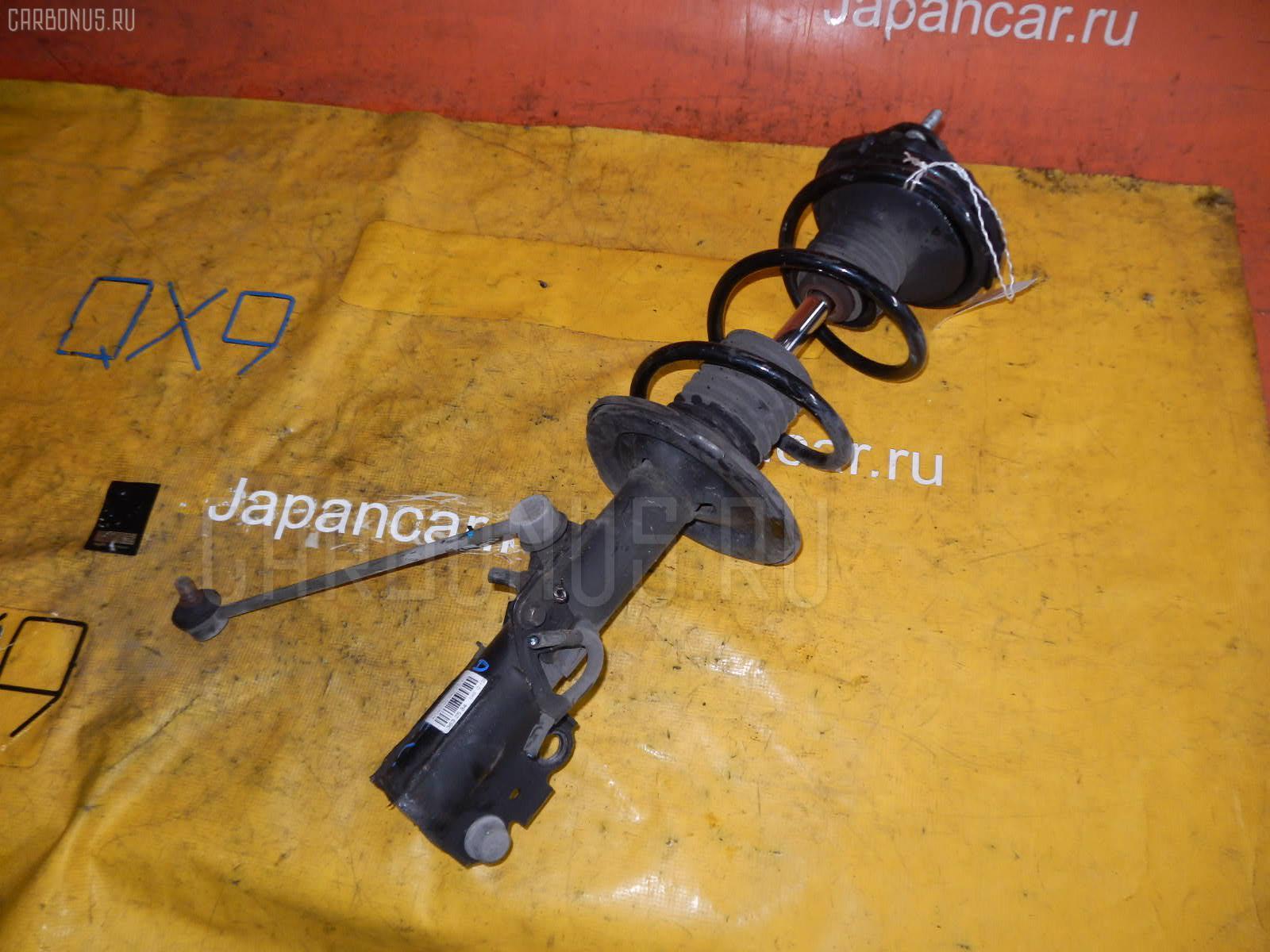 Стойка амортизатора Toyota Ipsum ACM21W 2AZ-FE Фото 1