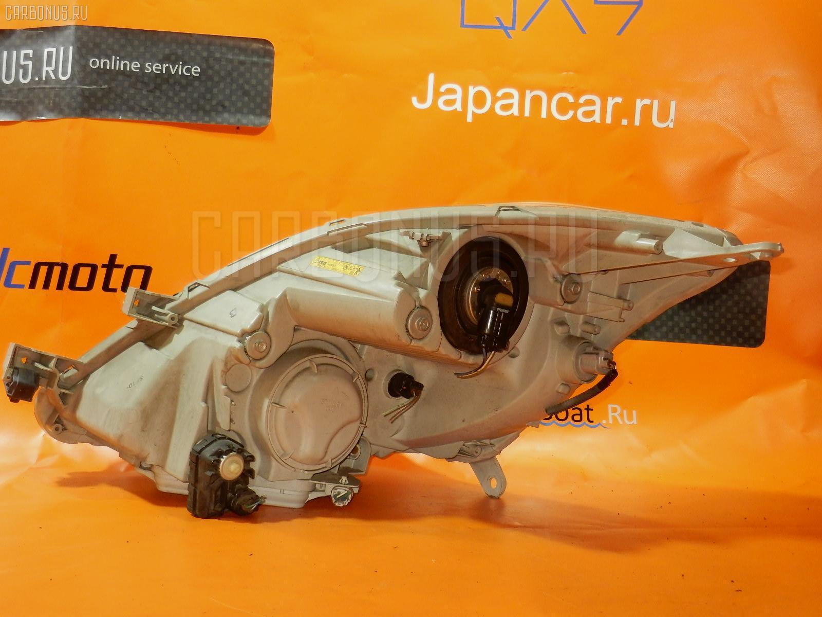 Фара 44-61 на Toyota Isis ANM10G Фото 1
