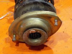 Стойка амортизатора SUZUKI ALTO HA12S F6A Переднее Левое