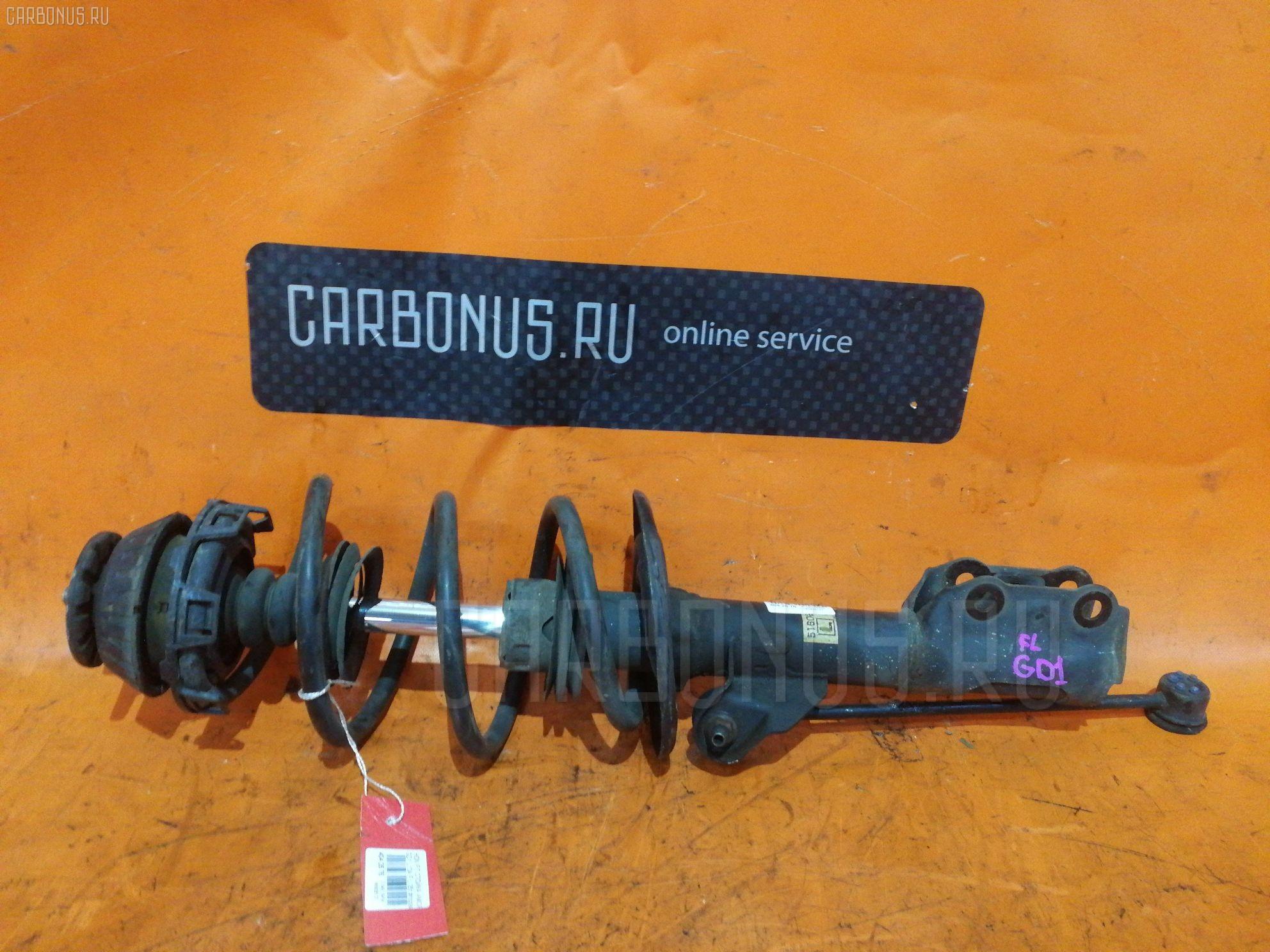 Стойка амортизатора на Honda Fit GD1 L13A Фото 1
