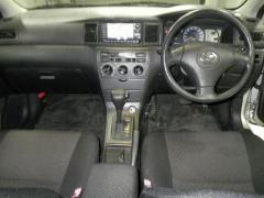 Крепление капота на Toyota Corolla Fielder NZE121G
