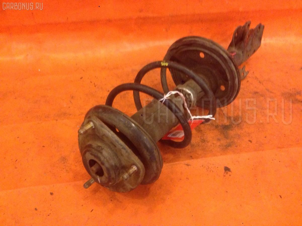 Стойка амортизатора на Mitsubishi Colt Z25A Фото 1