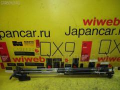 Амортизатор двери NISSAN CEFIRO WAGON WA32