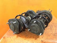 Стойка амортизатора на Toyota Caldina AZT246W 1AZ-FSE, Переднее расположение