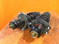 Стойка амортизатора на Toyota Caldina AZT246W 1AZ-FSE, Заднее расположение