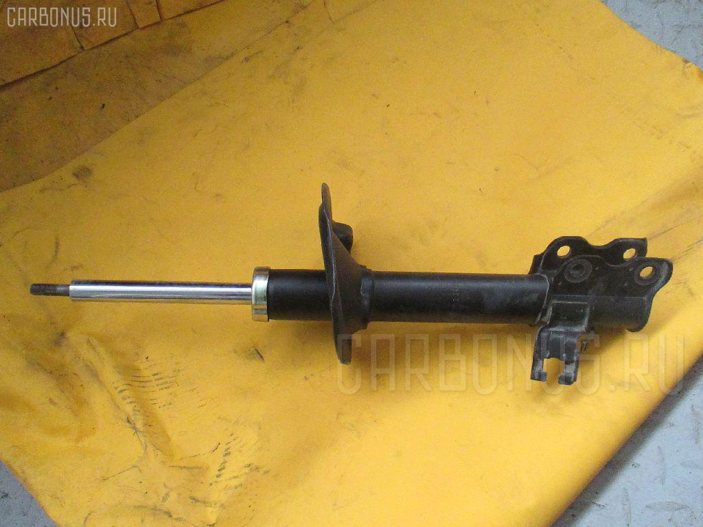 Стойка амортизатора NISSAN X-TRAIL NT30 Фото 1