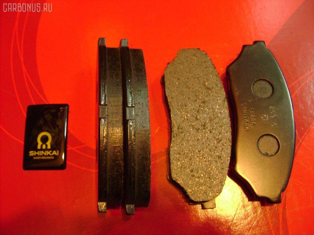 Тормозные колодки MITSUBISHI PAJERO IO H66W Фото 1