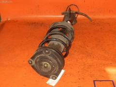 Стойка амортизатора NISSAN CUBE BZ11 CR14DE 543033U025 Переднее Левое