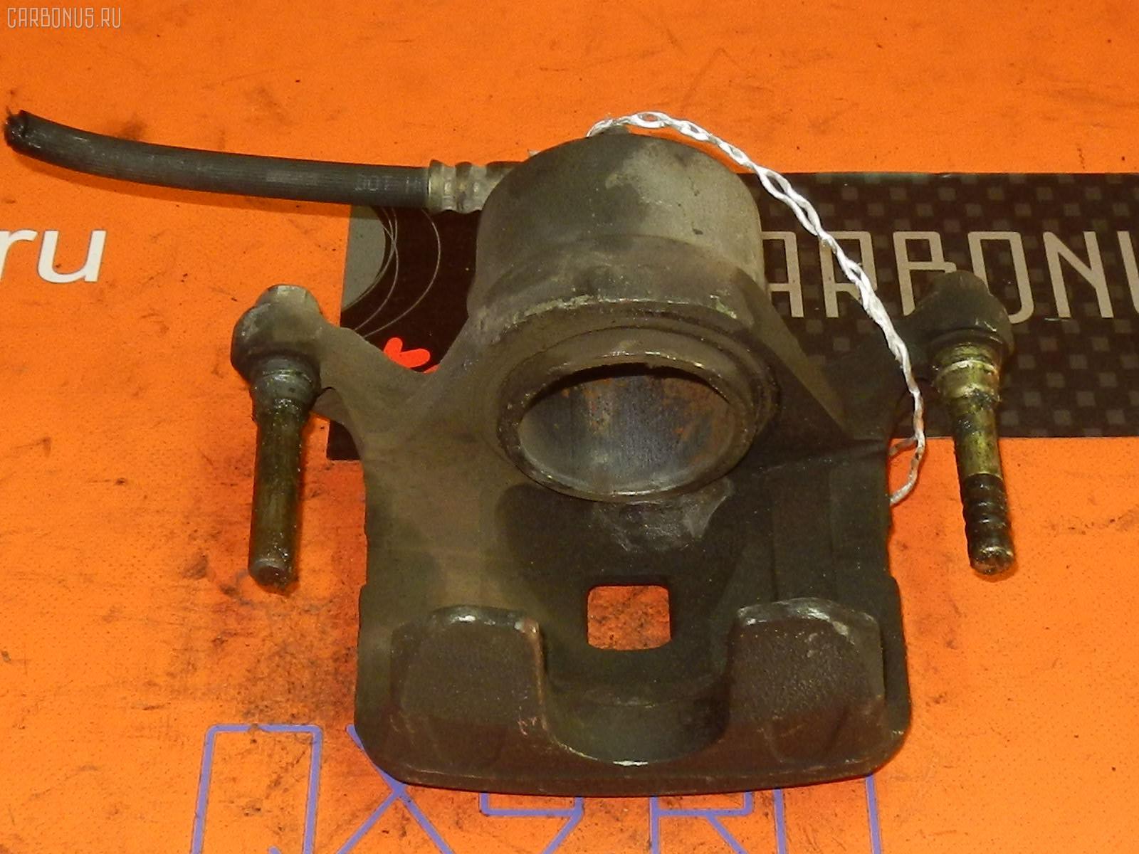 Суппорт NISSAN TINO V10 QG18DE Фото 2
