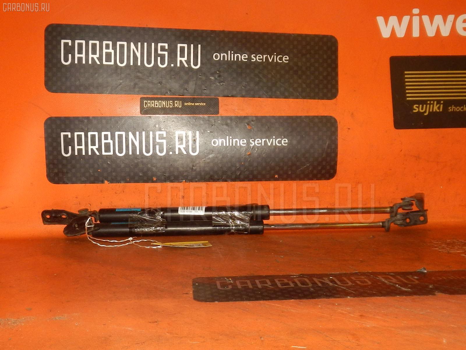 Амортизатор двери MAZDA PREMACY CP8W. Фото 8