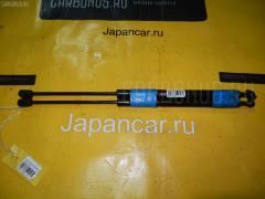 Амортизатор двери NISSAN RNESSA NN30 Фото 1