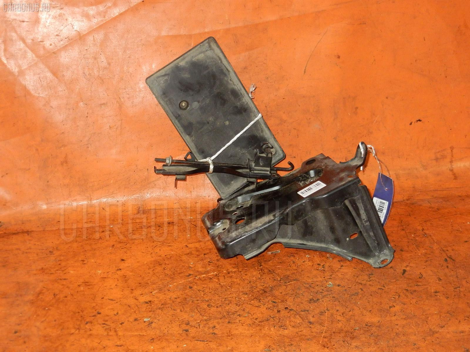 Подставка под аккумулятор Toyota Ractis SCP100 Фото 1