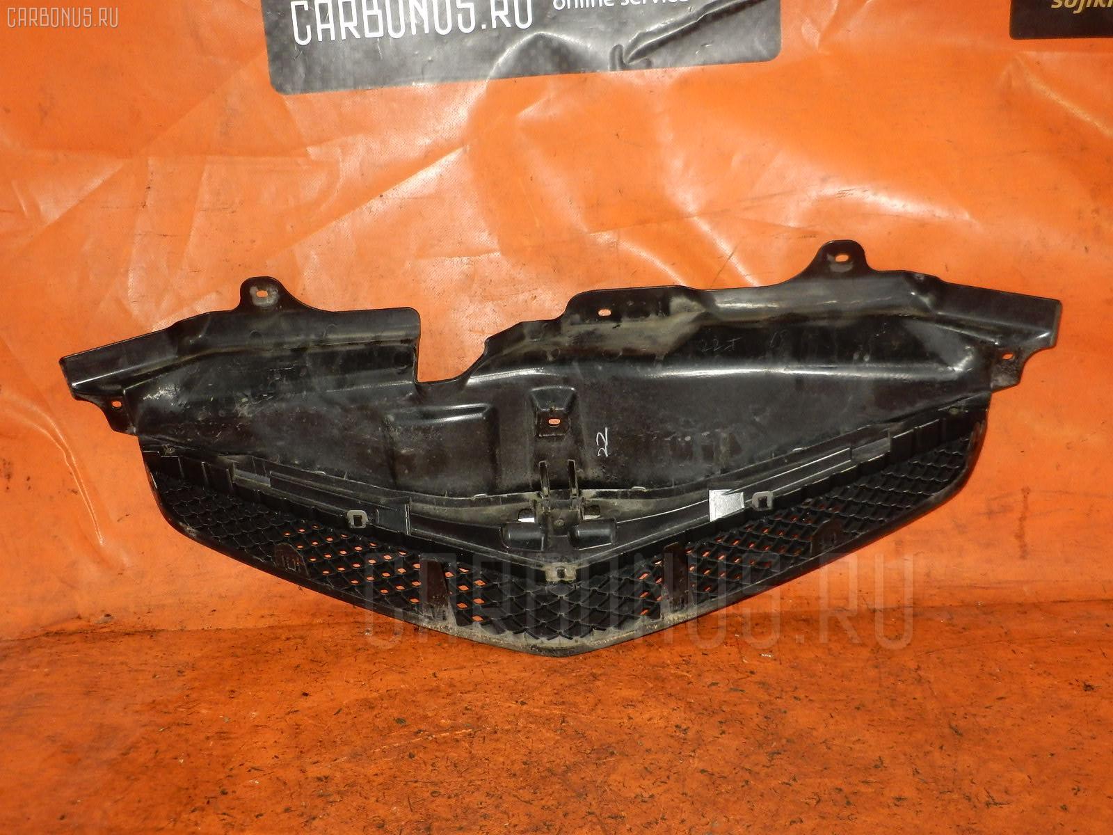 Решетка радиатора TOYOTA RACTIS SCP100 Фото 1