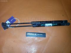 Амортизатор капота NISSAN CEFIRO A33 Фото 1