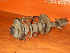 Стойка амортизатора Mitsubishi Pajero io H77W 4G93 Фото 1