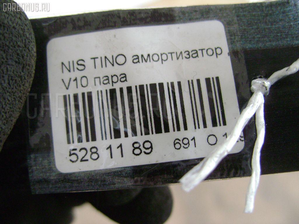 Амортизатор двери NISSAN TINO V10 Фото 2