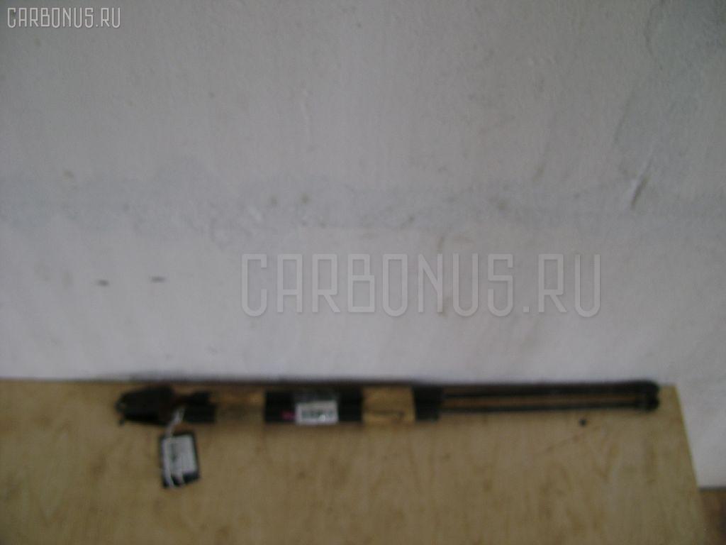Амортизатор двери Nissan Tino V10 Фото 1