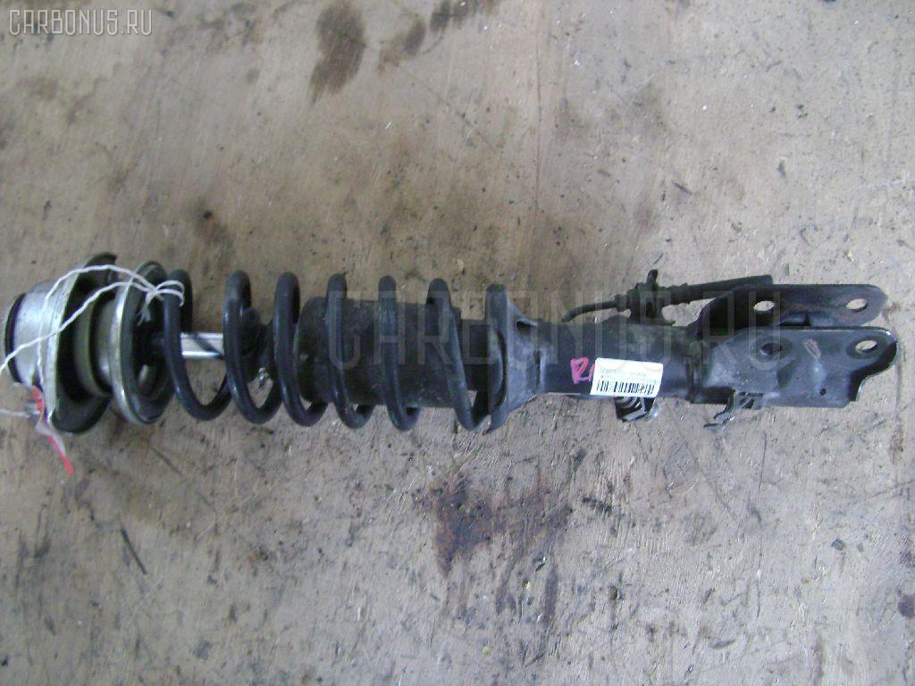 Стойка амортизатора Subaru Stella RN1 EN07 Фото 1