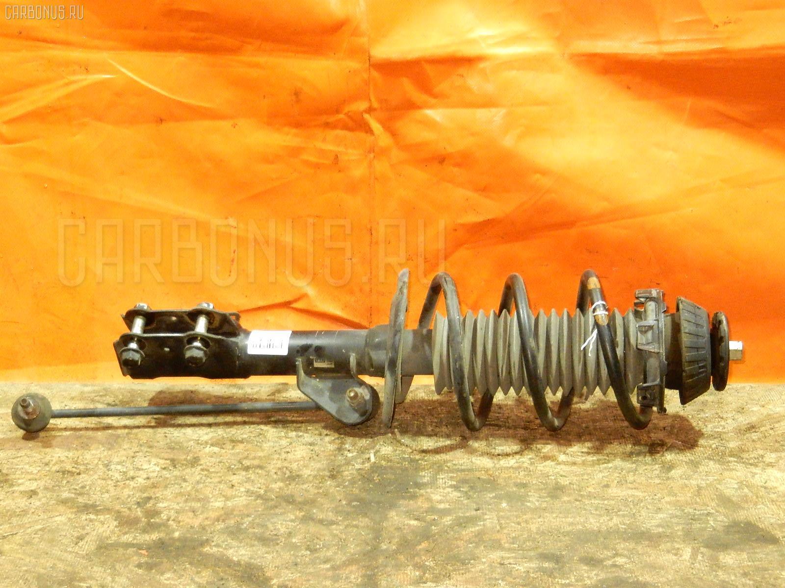 Стойка амортизатора Honda Fit GD1 L13A Фото 1