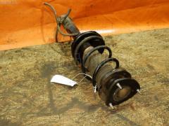 Стойка амортизатора TOYOTA VITZ SCP10 1SZ-FE Фото 2