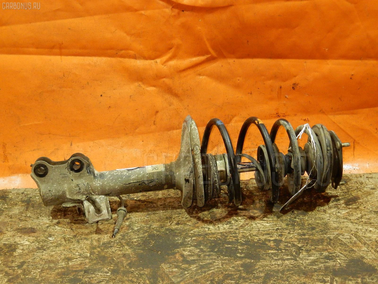Стойка амортизатора Nissan Ad VFY11 QG15DE Фото 1