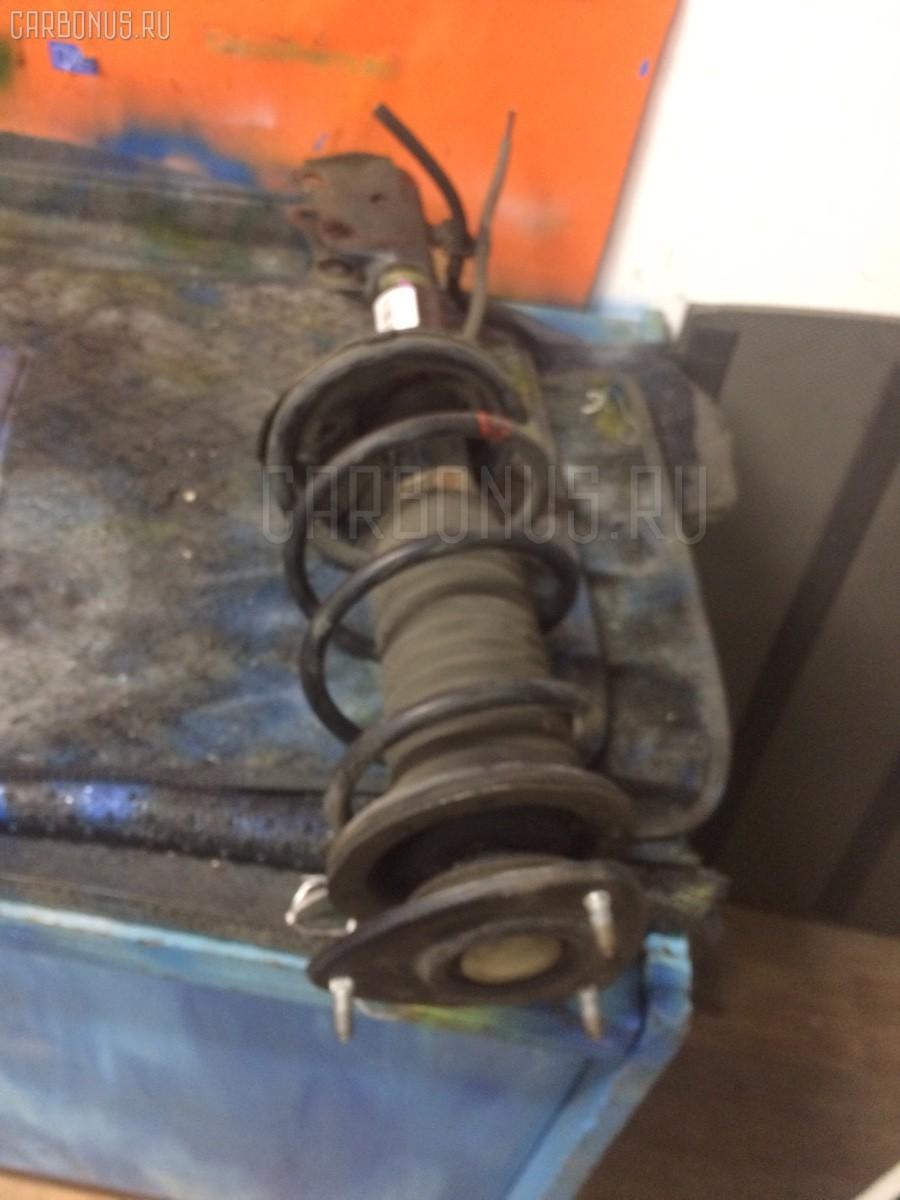 Стойка амортизатора Toyota Platz NCP12 1NZ-FE Фото 1