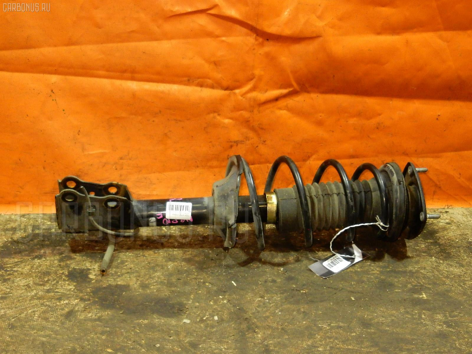 Стойка амортизатора Toyota Vitz NCP10 2NZ-FE Фото 1