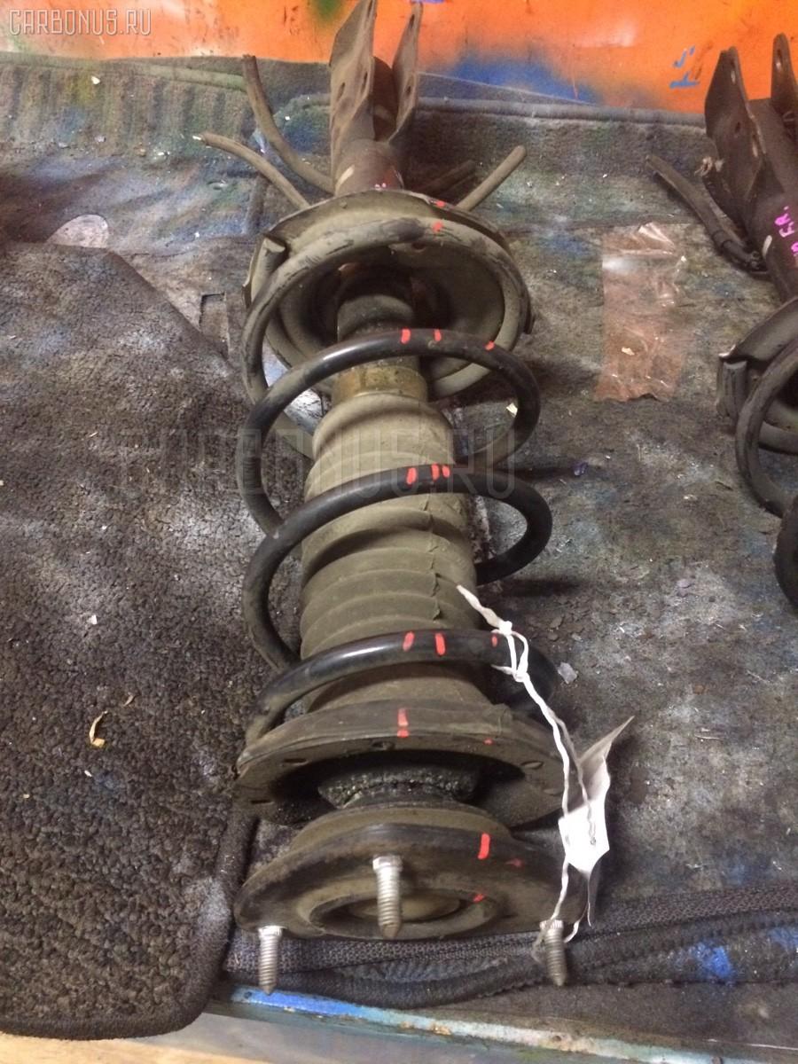 Стойка амортизатора Toyota Vitz SCP10 1SZ-FE Фото 1