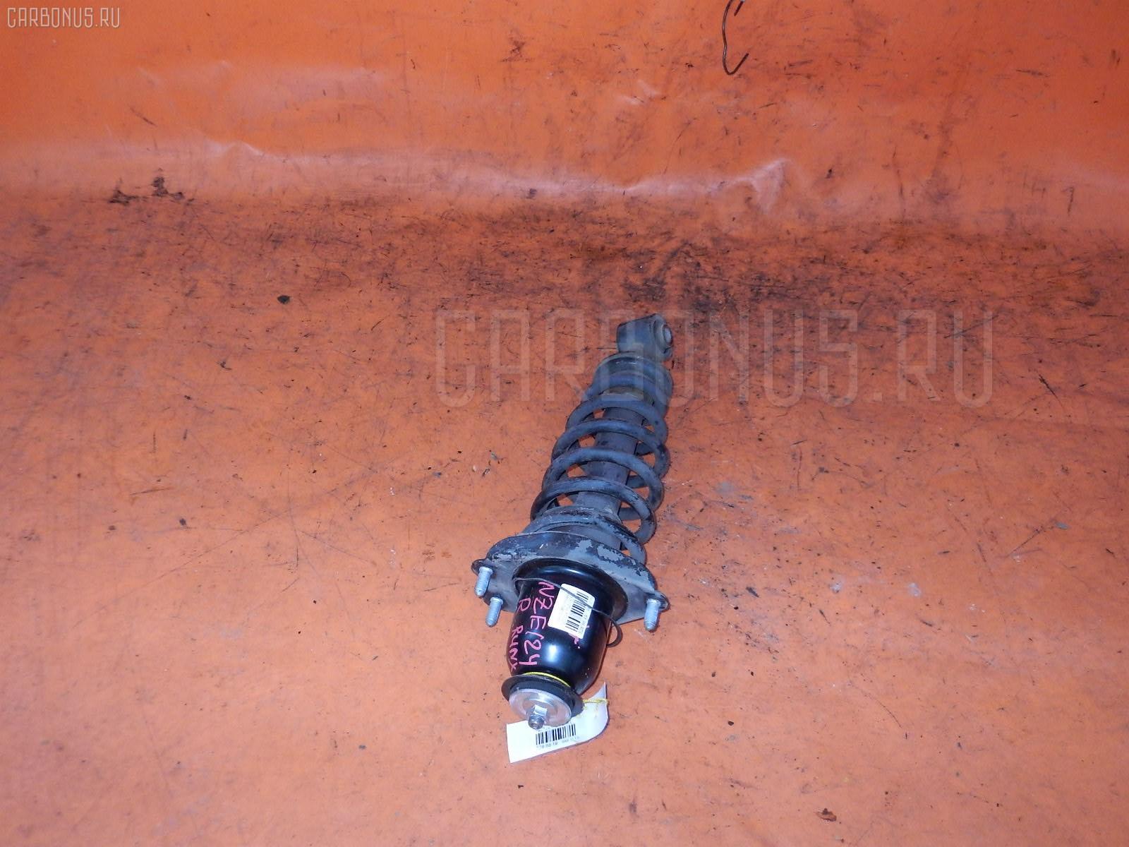 Стойка амортизатора TOYOTA COROLLA RUNX NZE124 1NZ-FE. Фото 2