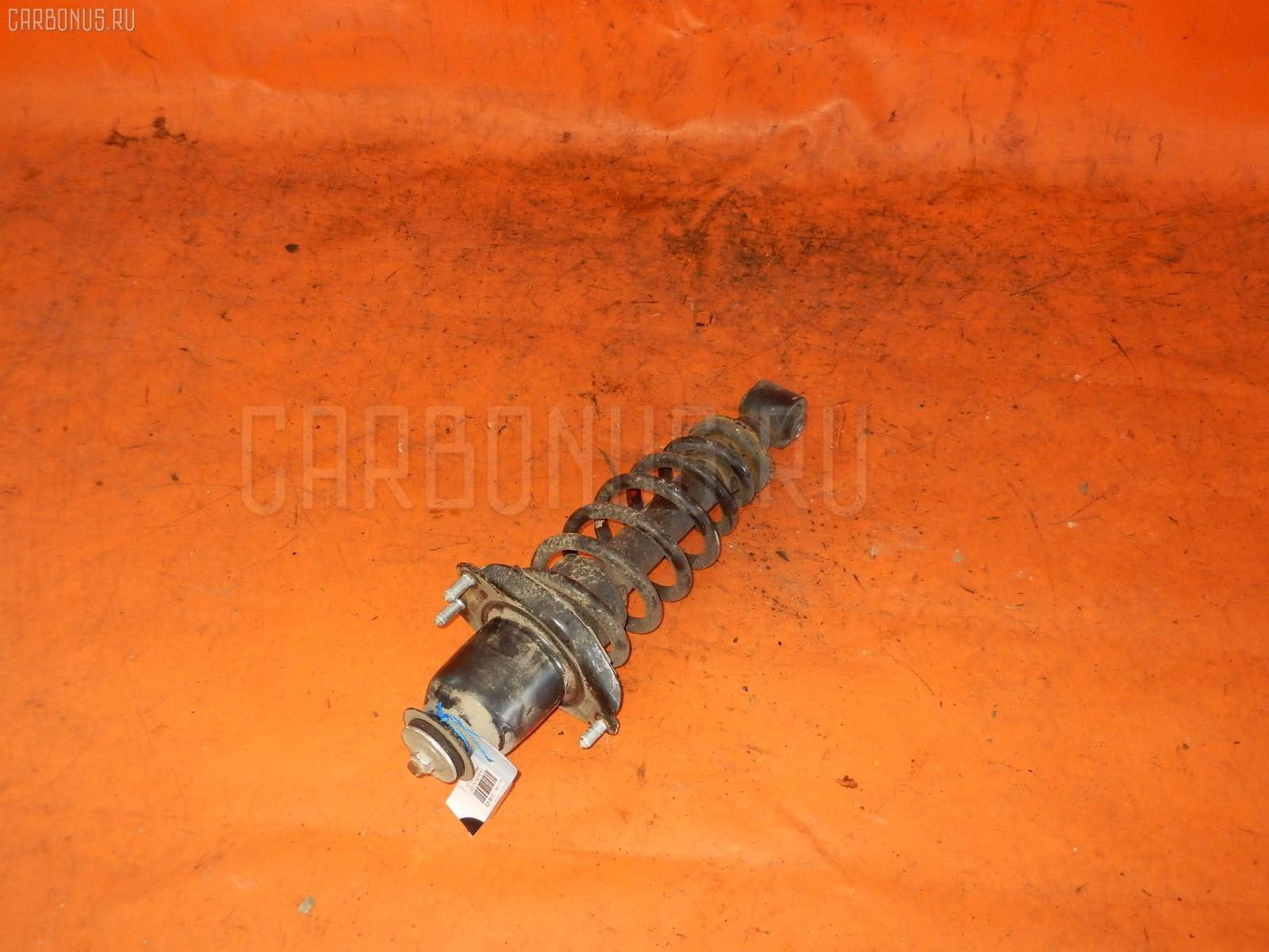 Стойка амортизатора TOYOTA COROLLA RUNX NZE124 1NZ-FE. Фото 3