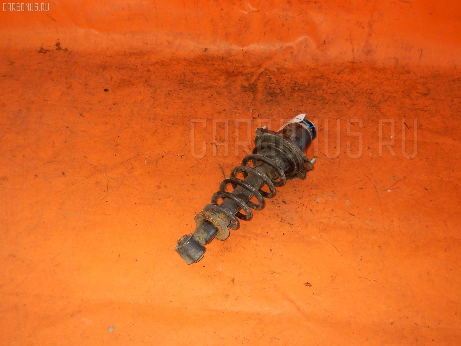 Стойка амортизатора TOYOTA COROLLA RUNX NZE124 1NZ-FE. Фото 4