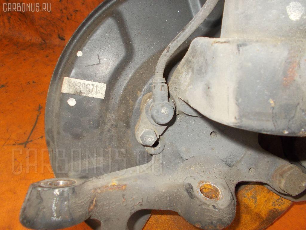 Стойка амортизатора на Nissan Cedric MY34 VQ25DD Фото 1
