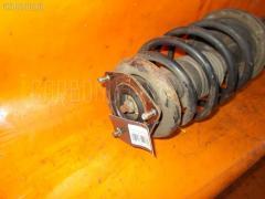 Стойка амортизатора NISSAN SUNNY FNB15 QG15 Переднее Правое
