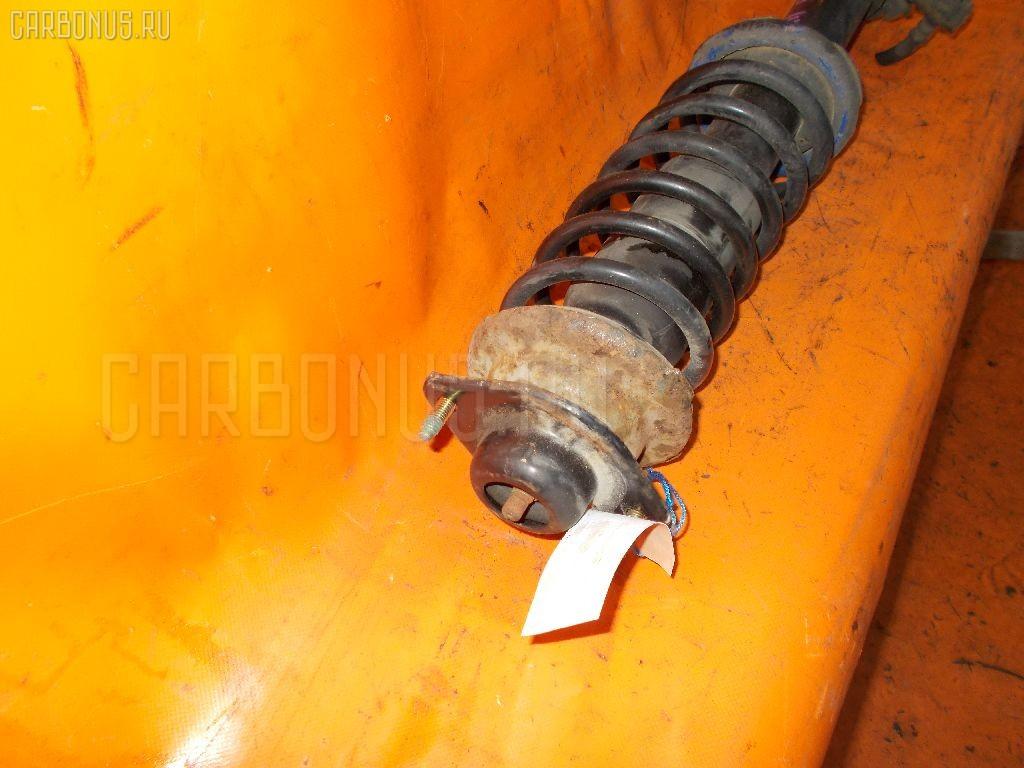Стойка амортизатора на Nissan March K11 CG10DE Фото 1