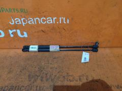 Амортизатор капота на Nissan Laurel GC35