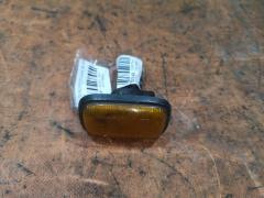 Поворотник в крыло на Daihatsu 012383